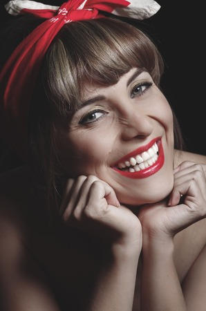 headband: Closeup portrait of pretty vintage girl wearing a red headband