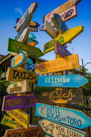 signal pole: distance signpost on a caribean island Stock Photo