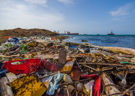 COLON, PANAMA - APRIL 15, 2015: Waste and pollution washing on the shores of the beach in city of Colon in Panama Imagens
