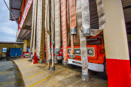 firetruck: BOCAS DEL TORO, PANAMA - APRIL 23, 2015 : Fire house hoses with firetruck on Bocas town.