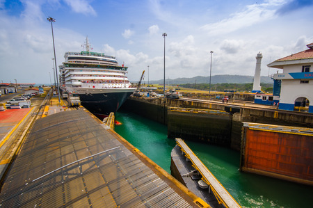 colon panama: COLON, PANAMA - APRIL 15, 2015: Queen Victoria transits the Panama Canal. This is the first set of locks situated on the Atlantic entrance of the Panama Canal.