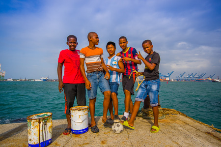 colon panama: COLON, PANAMA - APRIL 15, 2015: local teens hanging by the harbor where they fish and play football in the port of Colon in Panama. Editorial