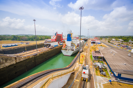 COLON, PANAMA - APRIL 15, 2015: Queen Elizabeth transits the Panama Canal. This is the first set of locks situated on the Atlantic entrance of the Panama Canal. Editorial