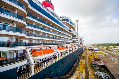 colon panama: COLON, PANAMA - APRIL 15, 2015: The Queen Victoria navigating the Panama Canal, is classified as a Panamax vessel, the largest the canal can accommodate. Gatun Locks.