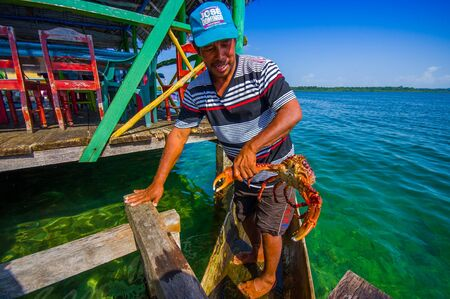 panama city beach: BOCAS DEL TORO, PANAMA - APRIL 24, 2015 : local fisherman returning with the morning catch, from local archipielago