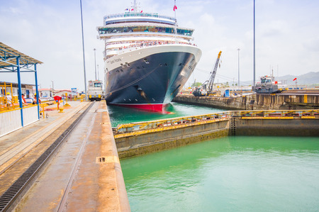 COLON, PANAMA - APRIL 15, 2015: The Queen Victoria navigating the Panama Canal, is classified as a Panamax vessel, the largest the canal can accommodate. Gatun Locks.
