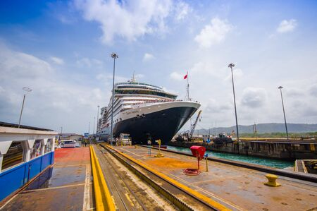 COLON, PANAMA - APRIL 15, 2015: SHip enters the Gatun Locks in the Panama Canal. This is the first set of locks situated on the Atlantic entrance of the Panama Canal. Editorial