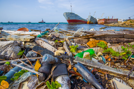 plastic waste: COLON, PANAMA - APRIL 15, 2015: Enviromental Pollution washing ashore next to the Panama Canal in the beach