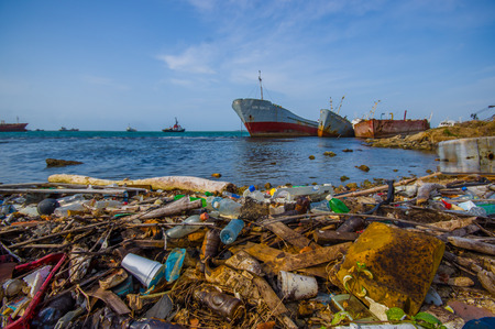 colon panama: COLON, PANAMA - APRIL 15, 2015: Enviromental Pollution washing ashore next to the Panama Canal in the beach