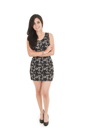 black dress: Beautiful young woman wearing a little black dress posing fullbody isolated on white Stock Photo