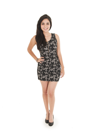 black dress: Beautiful young woman wearing a little black dress posing fullbody shot isolated on white Stock Photo