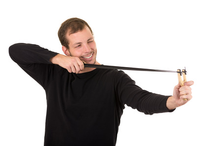 hansome: Hansome man concentrated aiming a slingshot isolated over white background.