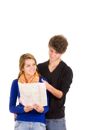 day dreams: Portrait of attractive young happy couple in love man and woman isolated over white background he shows her a map while she day dreams.