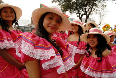 QUITO, ECUADOR - DECEMBER 5, 2010: Group of women dressed up with colorful dresses for the Quito Festivities parade