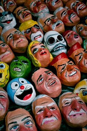 dummies: Traditional paper masks used to make stuffed dummies for New Year celebration in Ecuador Stock Photo