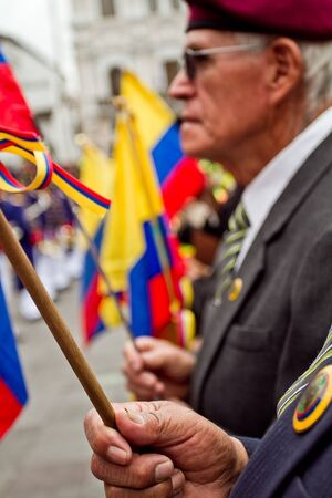 spectator: QUITO, ECUADOR - MARCH 3, 2014: Unknown spectator s with flags during Changing of the Guard, Presidential Palace in Quito, Ecuador Editorial