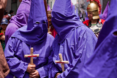 penitence: QUITO, ECUADOR - APRIL 22, 2011: Faaithful catholics participating in the Holy week procession