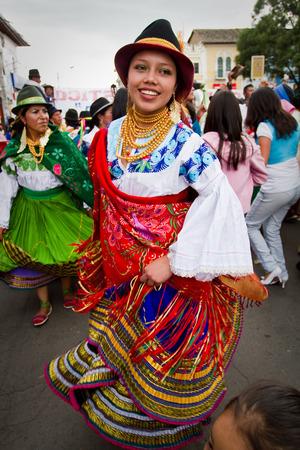 elaborate: PICHINCHA, ECUADOR - JUNE 30, 2011: Unidentified beautiful indigenous dancer with elaborate costume at Inti Raymi celebration in Cayambe, Ecuador