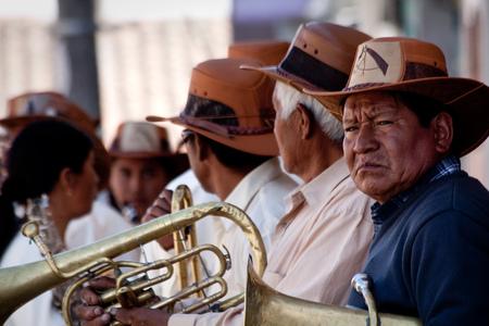 PICHINCHA, ECUADOR - OCTOBER 10, 2010: Unknown local indigenous people celebrating local festivities in Pintag