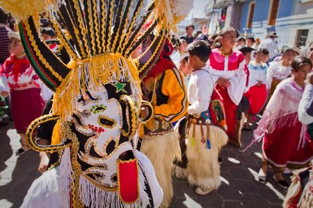 elaborate: PICHINCHA, ECUADOR - JUNE 30, 2011: Unidentified dancer with elaborate costume at Inti Raymi indigenous celebration in Cayambe, Ecuador Editorial