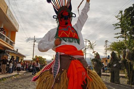 elaborate: PICHINCHA, ECUADOR - JUNE 27, 2011: Unidentified dancer with elaborate devil costume at Inti Raymi indigenous celebration in Alangasi, Ecuador Editorial