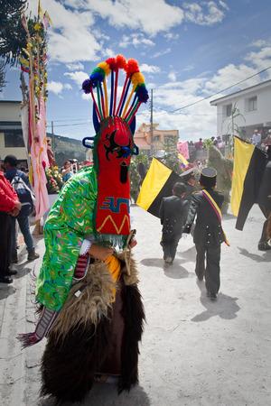 elaborate: PICHINCHA, ECUADOR - JUNE 27, 2011: Unidentified dancer with elaborate costume at Inti Raymi indigenous celebration in Alangasi, Ecuador
