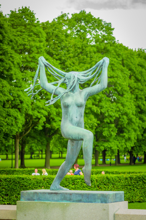 obelisk stone: OSLO, NORWAY - 8 JULY, 2015: Various nude sculptures in different positions as part of famous Vigelandsparken on a beautiful summer day.