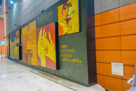 barajas: MADRID, SPAIN - 8 AUGUST, 2015: Artwork by Ecuadorian painter Oswaldo Guayasamin displayed on wall at Barajas Airport. Editorial