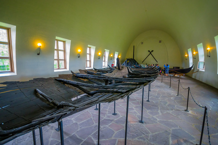 vikings: OSLO, NORWAY - 8 JULY, 2015: Ancient remains of old ship used by the vikings at official museum on Bygdoy.