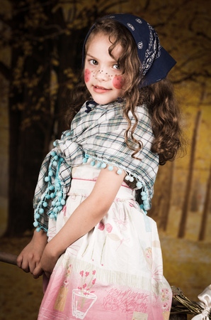 broomstick: Adorable little girl dressed as a traditional swedish easter witch sitting on a broomstick