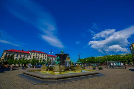 gothenburg: GOTHENBURG, SWEDEN - JUNE 21, 2015: Five Continents water fountain in Jarntorget Square in Gothenburg downtown