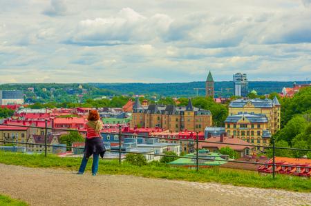 gothenburg: GOTHENBURG, SWEDEN - JUNE 21, 20015: Unknown tourist enjoyin the view of  Gothenburg city downtown on a summer day