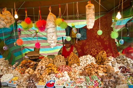 CANAR, ECUADOR - JUNE 19, 2010: Unknown indigenous woman selling traditional ecuadorian sweets Editorial