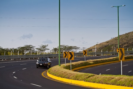 well maintained: AZOGUES, ECUADOR - MARCH 8, 2013: Modern and well maintained highway in Ecuador