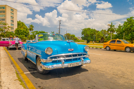 capitolio: HAVANA, CUBA - AUGUST 30, 2015: Old classic American cars used for taxi and tourist transportation. Before a new law issued on October 2011, cubans could only trade cars that were on the road before 1959.
