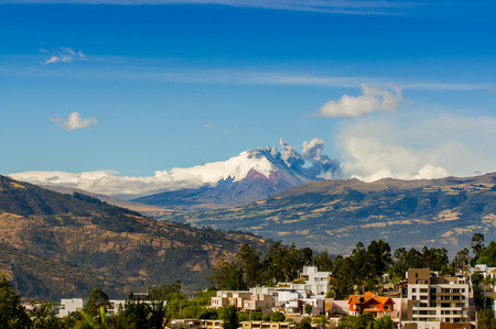 spews: QUITO, ECUADOR - AUGUST 18, 2015: Beautiful Cotopaxi volcano eruption spews ash cloud in Ecuador, South America Editorial