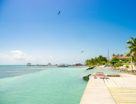 wooden dock: beautiful view of wooden dock above turquoise water in caye caulker belize caribbean Stock Photo