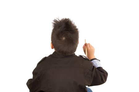 facing backwards: Little boy facing backwards, drawing in the air, isolated over white background.