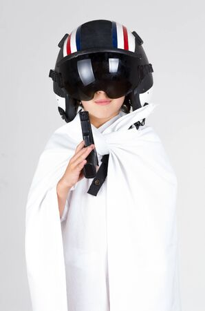 flight helmet: Cool kid posing wearing all white and flight helmet with reflected shades.