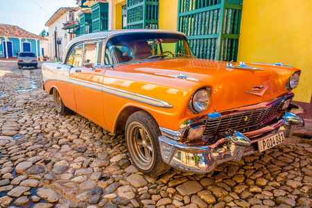 TRINIDAD, CUBA - SEPTEMBER 8, 2015: Classic Old American cars used for transportation and tourism services due to embargo. 에디토리얼