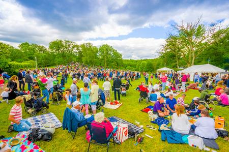 gothenburg: GOTHENBURG, SWEDEN - JUNE 19, 2015: Hundreds of visitors for the traditional Midsummer celebration in Gunnebo Castle Editorial