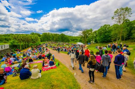 midsummer pole: GOTHENBURG, SWEDEN - JUNE 19, 2015: Visitors celebrating traditional Midsummer celebration in Gunnebo Castle
