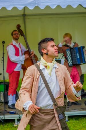 midsummer pole: GOTHENBURG, SWEDEN - JUNE 19, 2015: Theatrical performance during Midsummer celebration in Gunnebo Castle