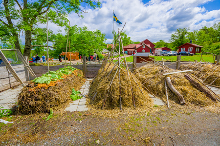 gunnebo: GOTHENBURG, SWEDEN - JUNE 19, 2015: Hay compost in Gunnebo House, beautiful and well preserved chateau built in the 18th century