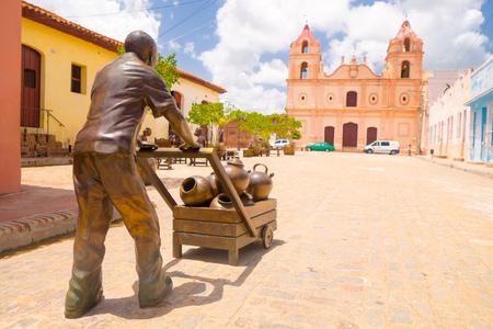 martha: CAMAGUEY, CUBA - SEPTEMBER 4, 2015:Statues of artist Martha Jimenez in front of the Carmen church.