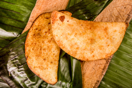 empanada is a stuffed bread or pastry baked or fried
