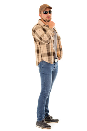 flannel: thinking trucker man with flannel shirt and cap Stock Photo