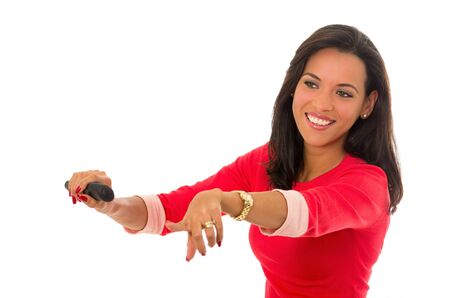 obsolete: woman posing as driving pointing on a white background