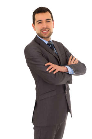 crossing arms: hispanic man crossing arms standing in a suit