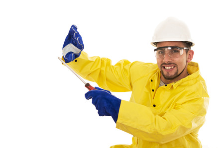 protective suit: man with screwdriver in yellow water protective suit Stock Photo